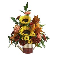 Sunflowers-carnations-lilies-and-mix-flowers-in-fall-beautiful-watering-can-container